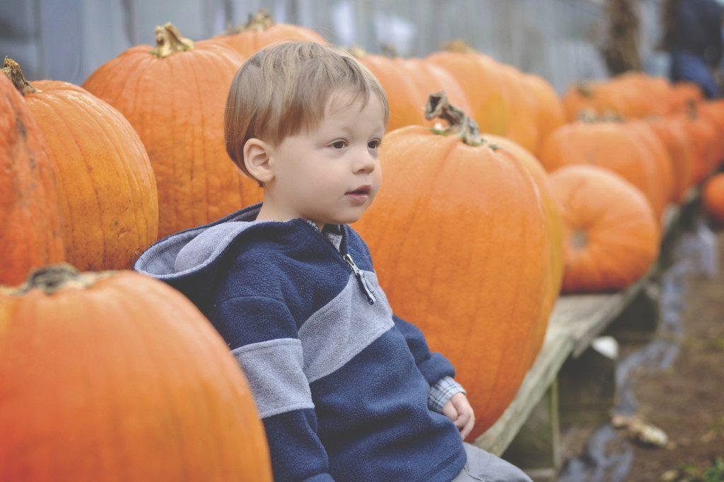 Andrew Near Pumpkins