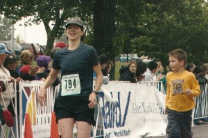Crossing the finish line at my first marathon with my oldest. Am I happy now?