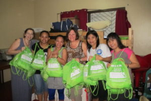 Midwives in the Philippines at Mercy In Action Birthing Center receiving Hats 4 hope Kits