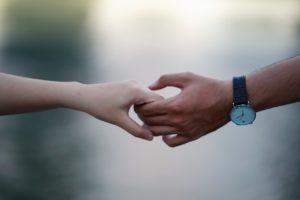 blurred-background-hands-holding-hands-715807