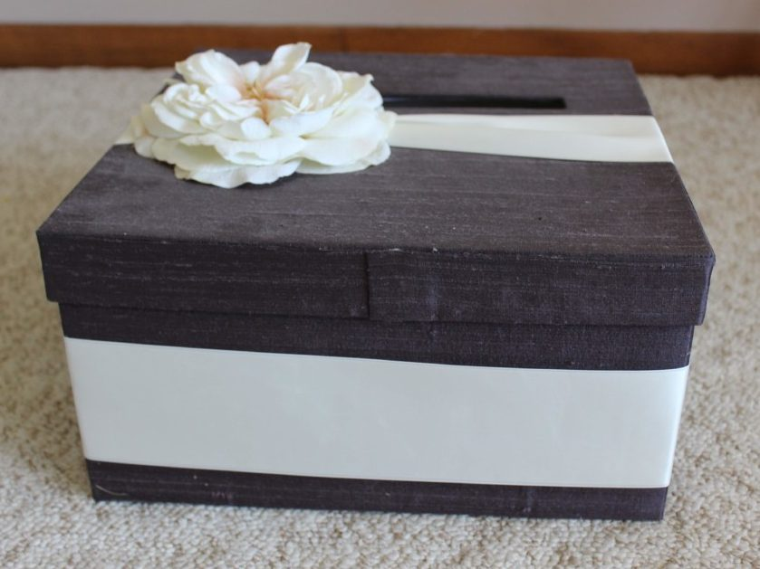 purple card box with ivory ribbon and flower