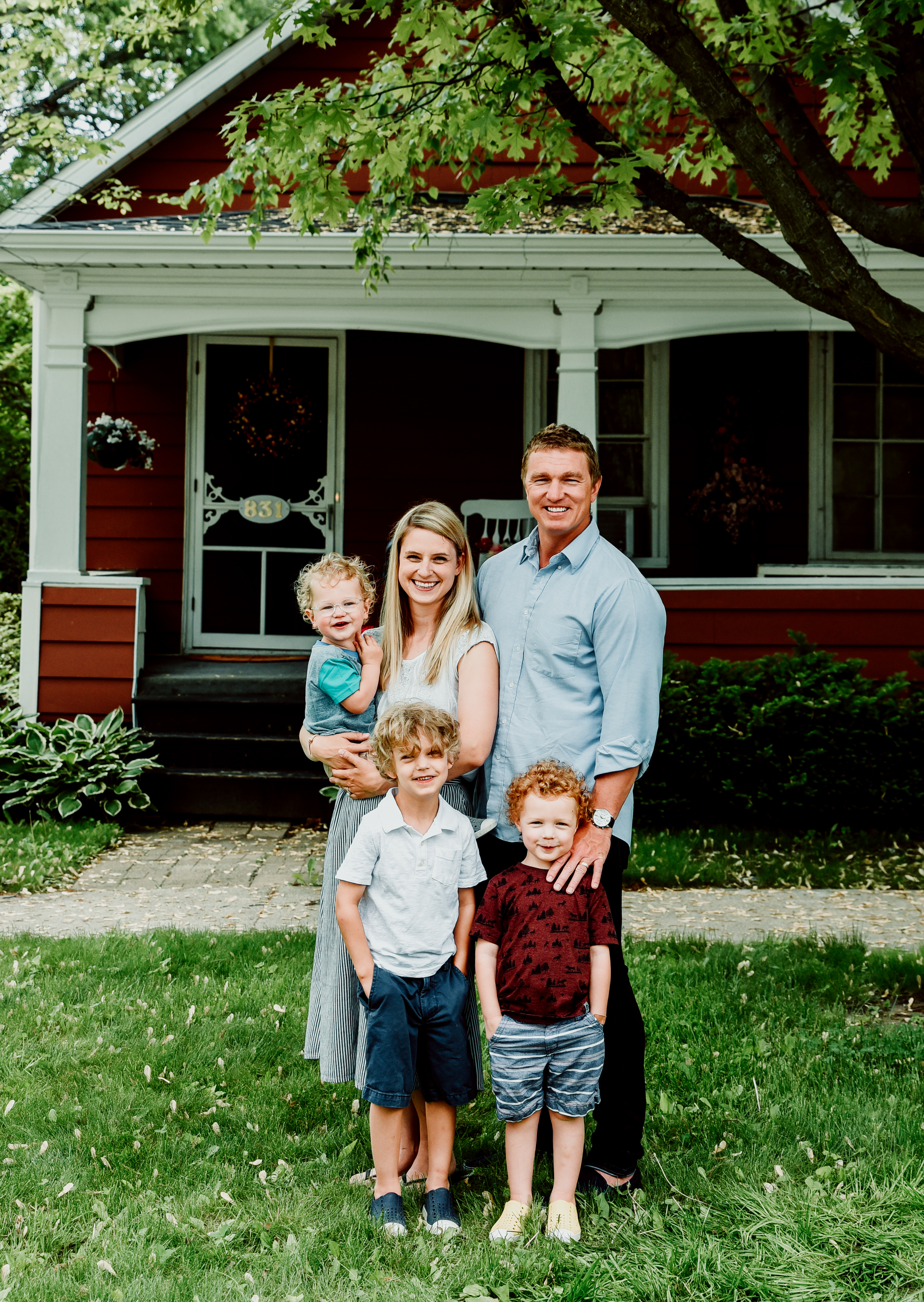 Author's family photo of her, husband, and three sons, standing and smiling at the camera.