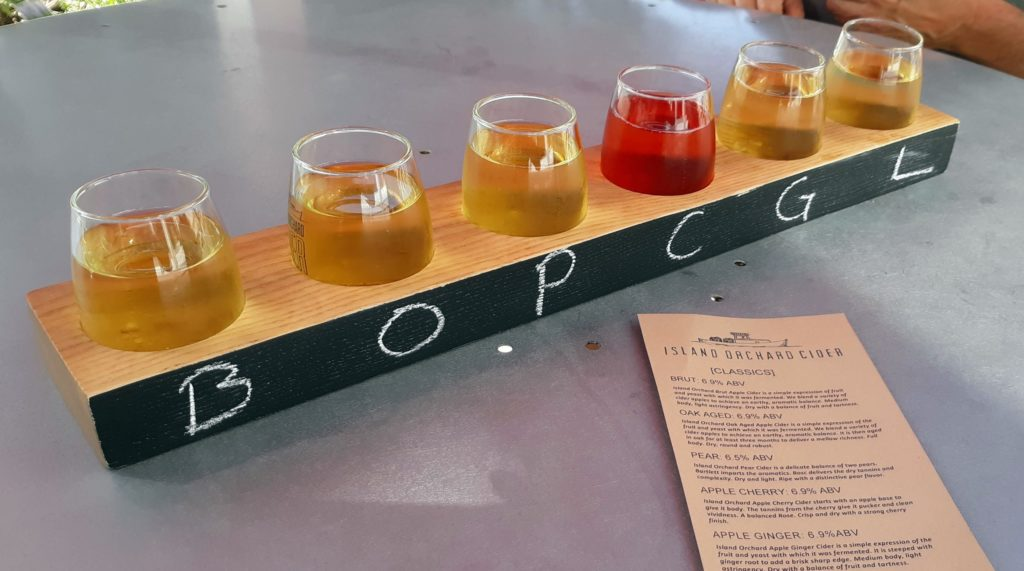 flight of different flavors of cider