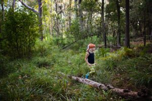 child in the woods outside