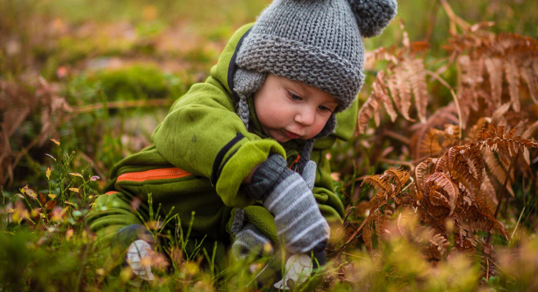 little kid playing in nature