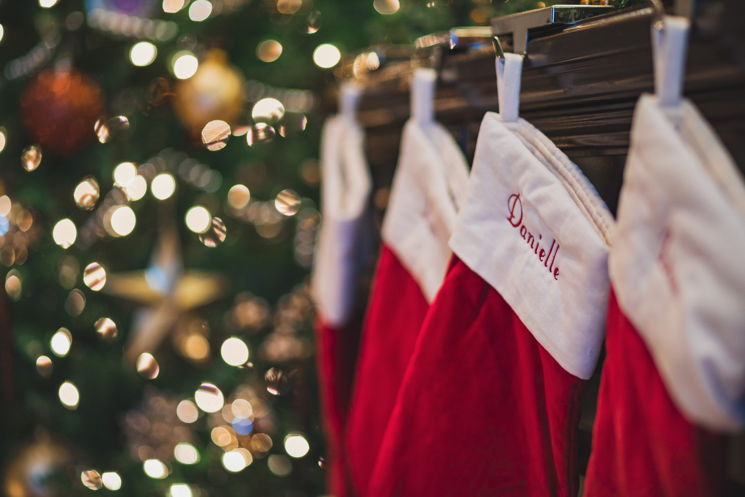 personalized stockings hung on mantel