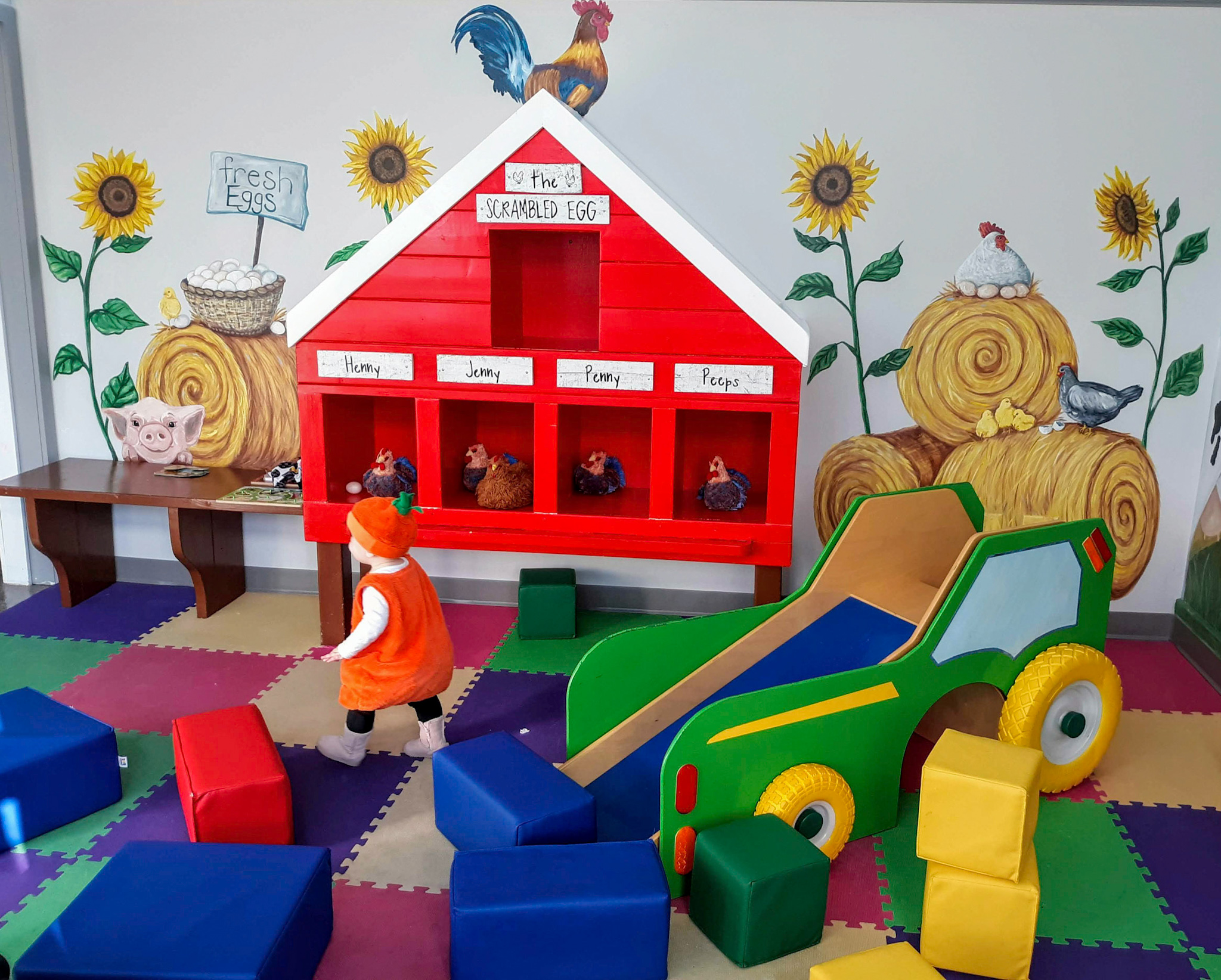 toddler in children's play area