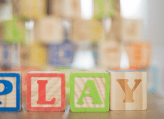 "wooden blocks that spell out ""play"""