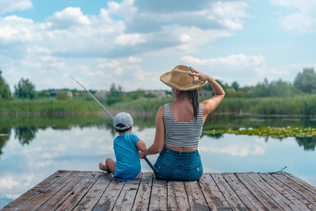 Woman and son fishing