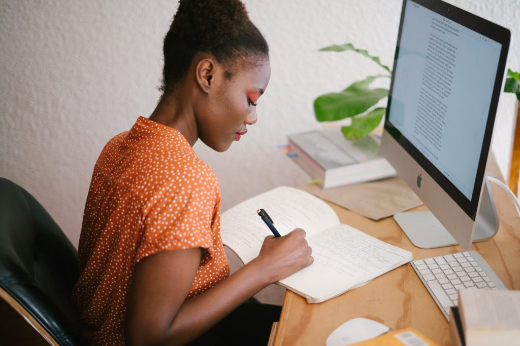woman working in front of computer